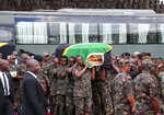 Members of the military carry the body of former president John Magufuli to lie in state at Uhuru stadium in Dar es Salaam, Tanzania Saturday, March 20, 2021. Magufuli, a prominent COVID-19 skeptic whose populist rule often cast his country in a harsh international spotlight, died Wednesday aged 61 of heart failure, it was announced by Vice President Samia Suluhu Hassan, who was sworn-in as the country's new president on Friday. (AP Photo)