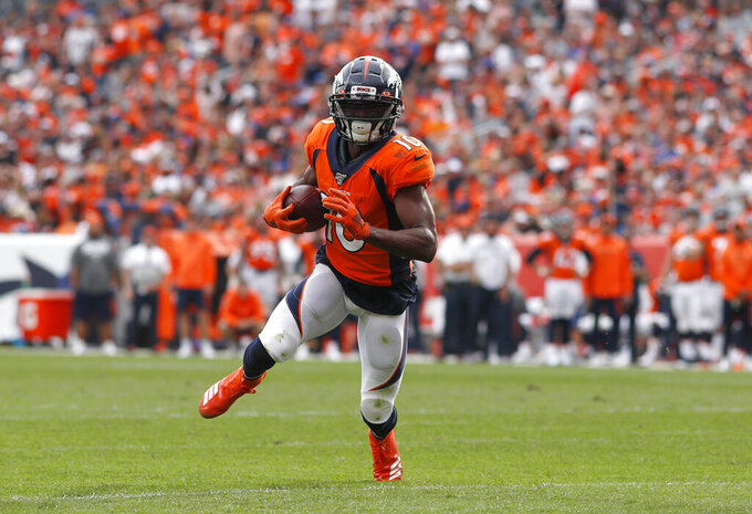 FILE - In this Sept. 15, 2019, file photo, Denver Broncos wide receiver Emmanuel Sanders carries the ball against the Chicago Bears during the second half of an NFL football game in Denver. The San Francisco 49ers have raced out to six straight wins to open the season despite lacking a dynamic receiver who could change a game in a single play. So when the opportunity to acquire a player like Sanders presented itself, the Niners didn't hesitate to make a move, giving up a pair of draft picks for a 32-year-old receiver in the final year of his contract. (AP Photo/David Zalubowski, File)
