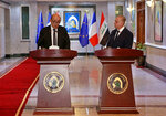 Iraqi Foreign Minister Mohamed Alhakim, right, and his visiting French counterpart Jean-Yves Le Drian hold a press conference at the Ministry of Foreign Affairs in Baghdad, Iraq, Thursday, Oct. 17, 2019. (AP Photo/Khalid Mohammed)