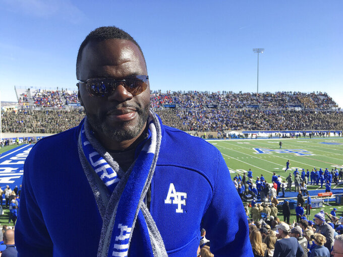In this Saturday, Nov. 2, 2019, photo, Jermaine Birdow stands at Falcon Stadium as his son, Air Force running back Taven Birdow, and his teammates play Army in an NCAA college football game at Air Force Academy, Colo. Jermaine Birdow, who was released from jail after serving a long sentence stemming from a 2001 home invasion, was able to see his son play for the first time at the game. (AP Photo/Pat Graham)
