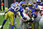 New York Giants quarterback Daniel Jones, center, is sacked by Los Angeles Rams cornerback Jalen Ramsey (20) during the first half of an NFL football game Sunday, Oct. 4, 2020, in Inglewood, Calif. (AP Photo/Jae C. Hong )