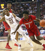 Louisville's Darius Perry, right, drives around the defense of Florida State's MJ Walker in the first half of an NCAA college basketball game Saturday, Feb. 9, 2019, in Tallahassee, Fla. (AP Photo/Steve Cannon)
