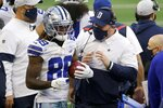 Dallas Cowboys wide receiver CeeDee Lamb (88) and head coach Mike McCarthy talk on the sideline after Lamb caught a San Francisco 49ers onside kick and returned it for a touchdown late in the second half of an NFL football game in Arlington, Texas, Sunday, Dec. 20, 2020. (AP Photo/Ron Jenkins)