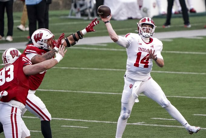 ndiana's Jack Tuttle throws a pass during the first half of an NCAA college football game against Wisconsin Saturday, Dec. 5, 2020, in Madison, Wis. (AP Photo/Morry Gash)