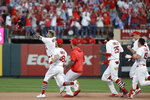 St. Louis Cardinals' Yadier Molina (4) celebrates after hitting a sacrifice fly to score Kolten Wong and defeat the Atlanta Braves in Game 4 of a baseball National League Division Series, Monday, Oct. 7, 2019, in St. Louis.  (AP Photo/Charlie Riedel)