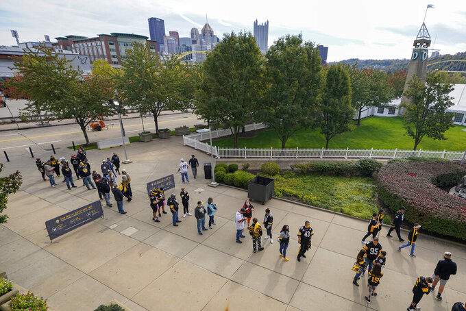 Fans line up before the gates open at Heinz Field for an NFL football game between the Pittsburgh Steelers and the Cleveland Browns, Sunday, Oct. 18, 2020, in Pittsburgh. (AP Photo/Keith Srakocic)