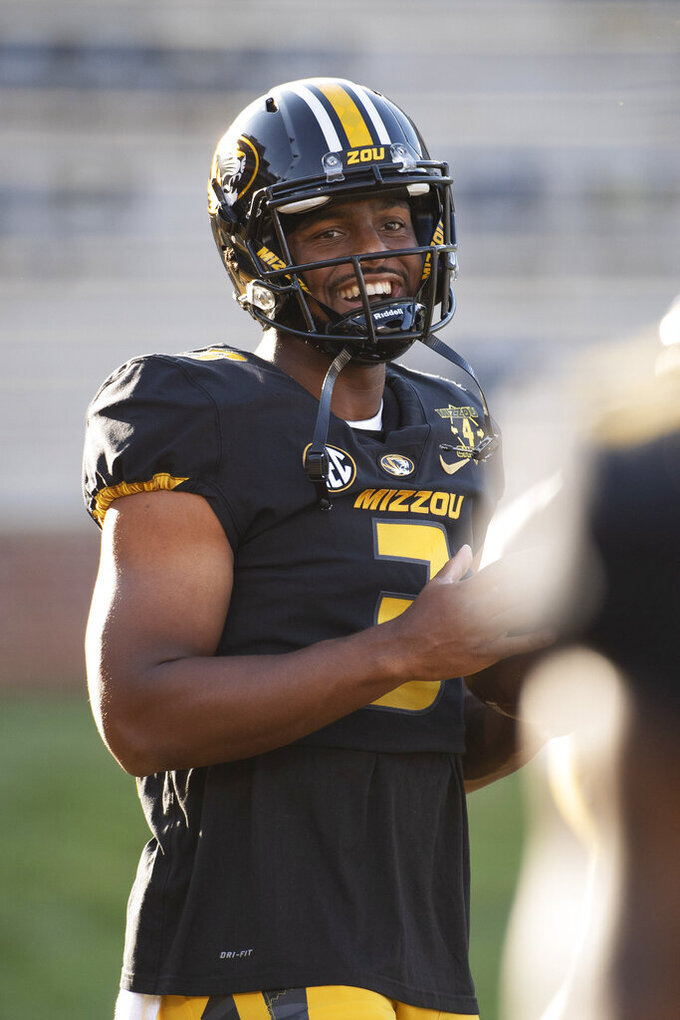 Missouri quarterback Shawn Robinson laughs with teammates before an NCAA college football game against Alabama, Saturday, Sept. 26, 2020, in Columbia, Mo. (AP Photo/L.G. Patterson)