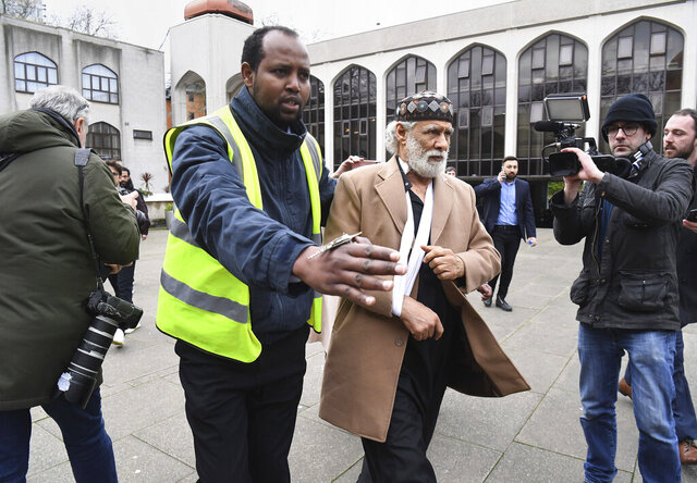Stabbing victim Muslim prayer leader Raafat Maglad arrives at the London Central Mosque after being released from hospital, Friday Feb. 21, 2020. A man was arrested on suspicion of attempted murder after an official at one of London's biggest mosques was stabbed during afternoon prayers on Thursday. (Kirsty O'Connor/PA via AP)