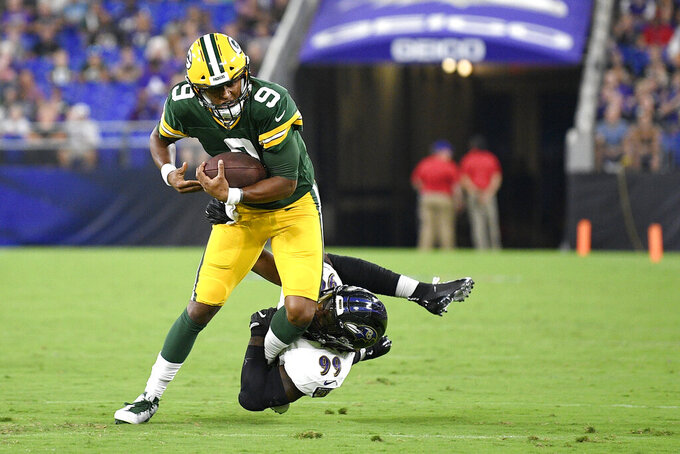 Green Bay Packers quarterback DeShone Kizer (9) is sacked by Baltimore Ravens outside linebacker Matt Judon (99) during the first half of a NFL football preseason game, Thursday, Aug. 15, 2019, in Baltimore. (AP Photo/Nick Wass)