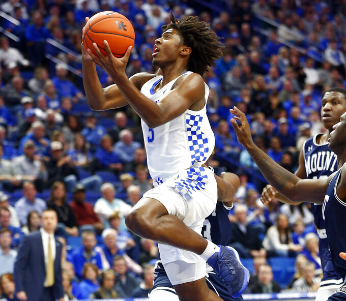 Kentucky's Tyrese Maxey, left, shoots near Mount St. Mary's Malik Jefferson during the first half of an NCAA college basketball game in Lexington, Ky., Friday, Nov. 22, 2019. (AP Photo/James Crisp)