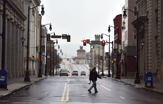 Businesses are closed and very few people are out in downtown Wilkes-Barre, Pa., Monday, March 23, 2020, heeding the advice of Gov. Tom Wolf. (Aimee Dilger/The Times Leader via AP)