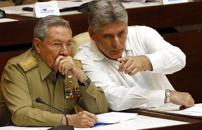 FILE - In this July 6, 2013 file photo, Cuba's President Raul Castro, left, and Vice President Miguel Diaz-Canel Bermudez attend the opening of a two-day, twice-annual legislative sessions, at the National Assembly in Havana, Cuba. Diaz-Canel, 57, is widely expected to take Castro's place as Cuba's next president on April 19. (AP Photo/Ismael Francisco, Cubadebate, File)