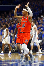 Auburn's Samir Doughty (10) celebrates a basket during the first half of an NCAA college basketball game against Kentucky in Lexington, Ky., Saturday, Feb. 29, 2020. (AP Photo/James Crisp)
