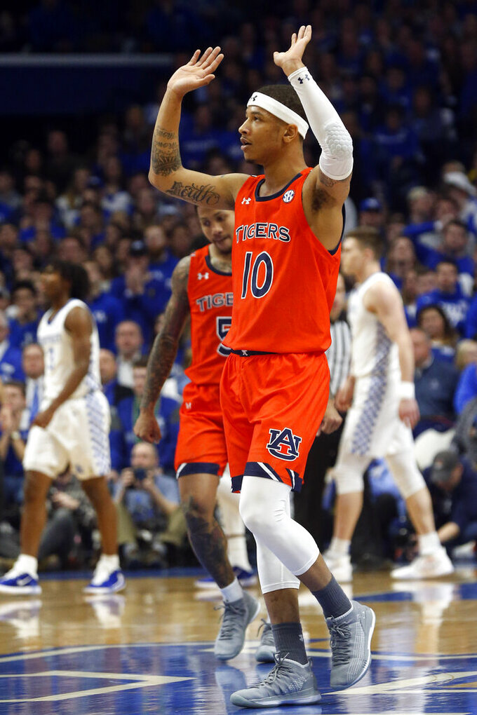 Auburn's Samir Doughty (10) celebrates a basket during the first half of an NCAA college basketball game against Kentucky in Lexington, Ky., Saturday, Feb. 29, 2020. (AP Photo/James Crisp)