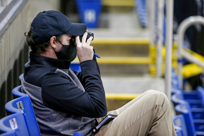 A scout for the New York Jets watches Central Arkansas play North Dakota State at an NCAA college football game Saturday, Oct. 3, 2020, in Fargo, N.D. North Dakota State won 39-28. (AP Photo/Bruce Kluckhohn)