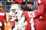 Stanford wide receiver Connor Wedington, left, carries the ball while pressured by Washington State linebacker Jahad Woods during the first half of an NCAA college football game in Pullman, Wash., Saturday, Nov. 16, 2019. (AP Photo/Young Kwak)