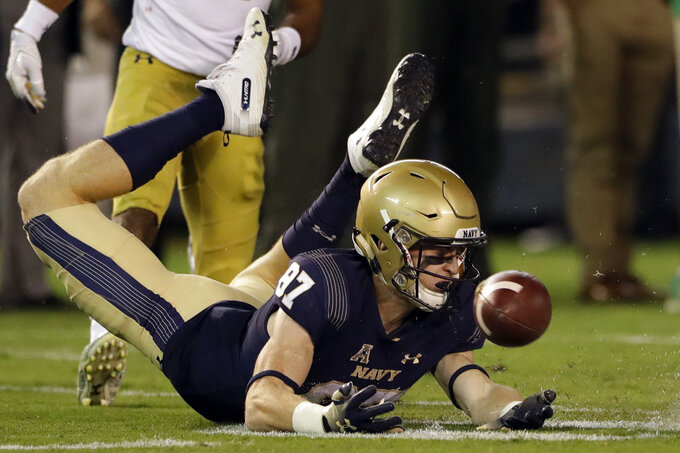 Navy wide receiver Ryan Mitchell misses a catch during the second half of an NCAA college football game against Notre Dame Saturday, Oct. 27, 2018, in San Diego. (AP Photo/Gregory Bull)