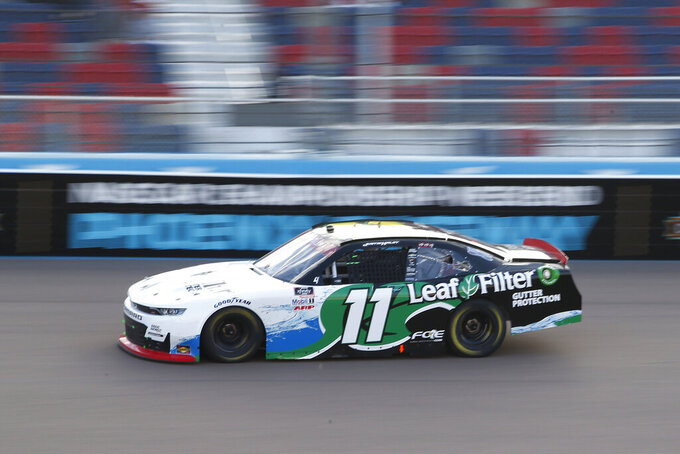 Justin Haley races through Turn 4 during the NASCAR Xfinity Series auto race at Phoenix Raceway, Saturday, Nov. 7, 2020, in Avondale, Ariz. (AP Photo/Ralph Freso)