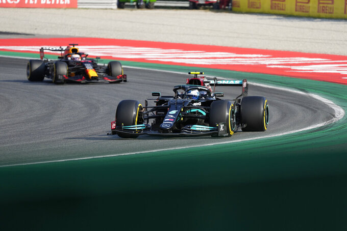 Mercedes driver Valtteri Bottas of Finland leads Red Bull driver Max Verstappen of the Netherlands during the Sprint Race qualifying session at the Monza racetrack, in Monza, Italy , Saturday, Sept.11, 2021. The Formula one race will be held on Sunday. (AP Photo/Luca Bruno)
