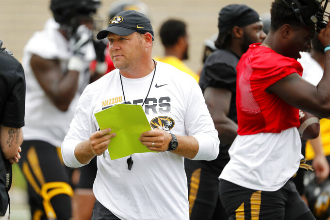 Missouri head coach Barry Odom watches his players during an NCAA college football practice Monday, Aug. 12, 2019, in Columbia, Mo. (AP Photo/Jeff Roberson)