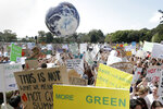A large inflatable globe is bounced through the crowd as thousands of protestors, many of them school students, gather in Sydney, Friday, Sept. 20, 2019, calling for action to guard against climate change. Australia's acting Prime Minister Michael McCormack has described ongoing climate rallies as