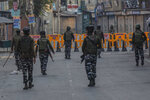 Paramilitary soldiers patrol a deserted street on the first anniversary of India's decision to revoke the disputed region's semi-autonomy, in Srinagar, Indian controlled Kashmir, Wednesday, Aug. 5, 2020. Last year on Aug. 5, India's Hindu-nationalist-led government of Prime Minister Narendra Modi stripped Jammu-Kashmir of its statehood and divided it into two federally governed territories. Late Tuesday, authorities lifted a curfew in Srinagar but said restrictions on public movement, transport and commercial activities would continue because of the coronavirus pandemic. (AP Photo/ Dar Yasin)