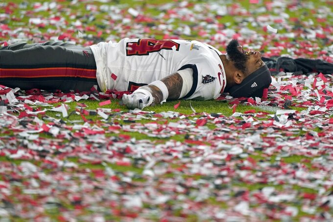 Tampa Bay Buccaneers cornerback Carlton Davis celebrates on the field after their NFL Super Bowl 55 football game against the Kansas City Chiefs, Sunday, Feb. 7, 2021, in Tampa, Fla. The Buccaneers defeated the Chiefs 31-9 to win the Super Bowl. (AP Photo/Gregory Bull)