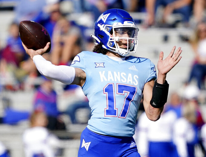Kansas quarterback Jason Bean looks to pass against Texas Tech during in first quarter of an NCAA college football game Saturday, Oct. 16, 2021, in Lawrence, Kan. (AP Photo/Ed Zurga)