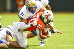 Tulsa defensive end Bryce Alonso (91) tackles Oklahoma State running back Chuba Hubbard (30) during the first half of an NCAA college football game, Saturday, Sept. 19, 2020, in Stillwater, Okla. (AP Photo/Brody Schmidt)