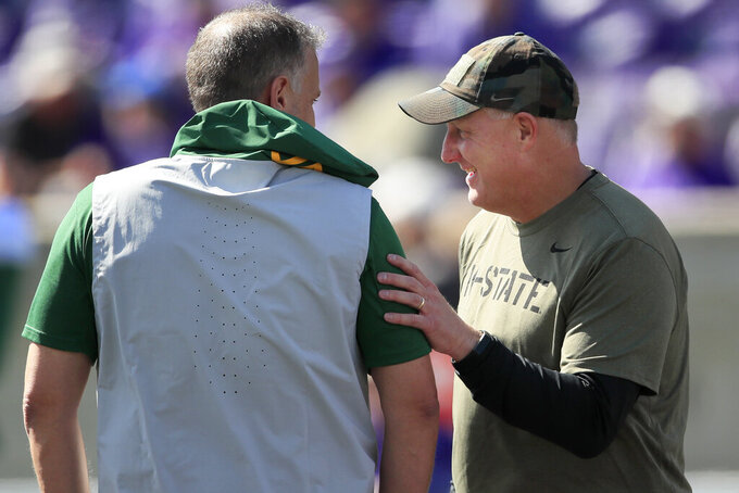 Kansas State head coach Chris Klieman, right, talks with Baylor head coach Matt Rhule, left, before an NCAA college football game in Manhattan, Kan., Saturday, Oct. 5, 2019. (AP Photo/Orlin Wagner)