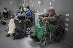 Patients testing positive for the new coronavirus breathe in oxygen in the emergency area of the Guillermo Almenara hospital in Lima, Peru, Friday, May 22, 2020. As more of the poor fall sick, the hospitals that serve them are emerging as some of the most stretched. (AP Photo/Rodrigo Abd)