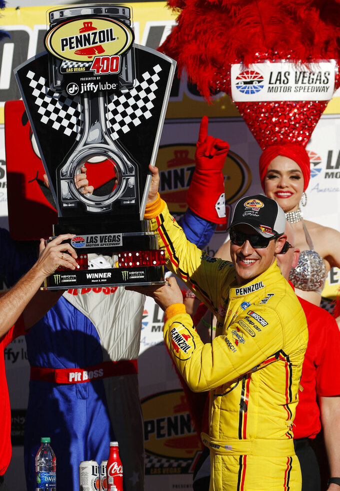 Joey Logano holds up the trophy after winning a NASCAR Cup Series auto race at Las Vegas Motor Speedway, Sunday, March 3, 2019, in Las Vegas. (AP Photo/John Locher)