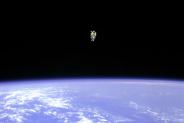 """FILE - In this Feb. 12, 1984 photo made available by NASA, astronaut Bruce McCandless uses a nitrogen jet-propelled backpack, a Manned Manuevering Unit, outside the space shuttle Challenger. Astronaut wannabe Rachel Zimmerman-Brachman, a public engagement specialist at NASA's Jet Propulsion Laboratory, says that isolation is a lot like astronaut training. On Thursday, March 19, 2020, she wrote on Facebook,""""Attitude is everything: I'm on an adventure in a confined space with a small crew for a long duration mission, with occasional space walks and resupply missions. Sounds like astronaut training to me.""""(NASA via AP)"""
