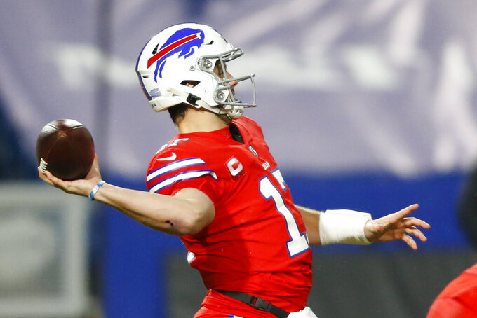Buffalo Bills quarterback Josh Allen (17) throws a pass during the first half of an NFL football game against the Pittsburgh Steelers in Orchard Park, N.Y., Sunday, Dec. 13, 2020. (AP Photo/Jeffrey T. Barnes )