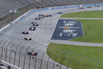 Scott Dixon, bottom, leads the field into Turn 1 during an IndyCar auto race at Texas Motor Speedway in Fort Worth, Texas, Saturday, June 6, 2020. Dixon won the race. (AP Photo/Tony Gutierrez)