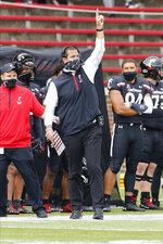 Cincinnati head coach Luke Fickell instructs his team against Army during the first half of an NCAA college football game Saturday, Sept. 26, 2020, in Cincinnati, Ohio. Cincinnati beat Army 24-10. (AP Photo/Jay LaPrete)