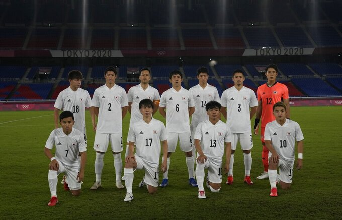 Japan team pose for a group photo prior to men's soccer match against France at the 2020 Summer Olympics, Wednesday, July 28, 2021, in Yokohama. (AP Photo/Kiichiro Sato)