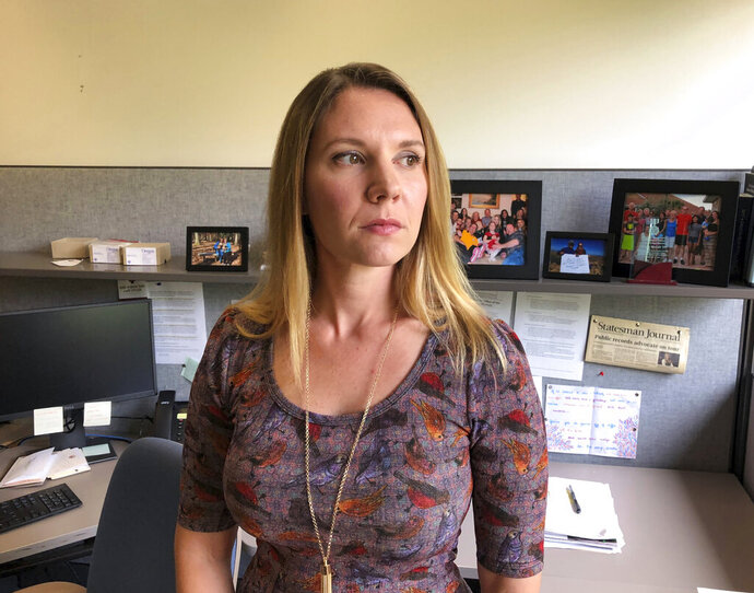 In this Wednesday, Sept. 11, 2019 photo, Ginger McCall, Oregon's first public records advocate, poses for photos in her office in Salem. Faced with what she thought was undue interference and disrespect shown by Gov. Kate Brown's general counsel, McCall whose job is aimed at making government more transparent resigned. Her resignation has blown up into a debacle for the Democratic governor's office. (AP Photo/Andrew Selsky)