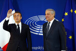 French President Emmanuel Macron, left, is welcomed by European Parliament president Antonio Tajani upon his arrival at the European Parliament in Strasbourg, eastern France, Tuesday, April 17, 2018. In his speech to European lawmakers Tuesday in Strasbourg, France, Macron will launch a drive to seek European citizens' opinions on the European Union's future. (AP Photo/ Jean Francois Badias)