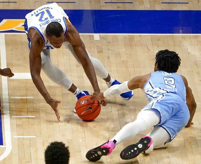 Pittsburgh's Abdoul Karim Coulibaly (12) and North Carolina's Caleb Love (2) reach for the ball during the second half of an NCAA college basketball game, Tuesday, Jan. 26, 2021, in Pittsburgh. (AP Photo/Keith Srakocic)