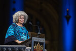 Author Angela Davis speaks during the Celebration of the Life of Toni Morrison, Thursday, Nov. 21, 2019, at the Cathedral of St. John the Divine in New York. Morrison, a Nobel laureate, died in August at 88. (AP Photo/Mary Altaffer)