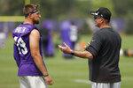 Minnesota Vikings coach Mike Zimmer, right, talks to wide receiver Adam Thielen during NFL football training camp Wednesday, July 28, 2021, in Eagan, Minn. (AP Photo/Bruce Kluckhohn)