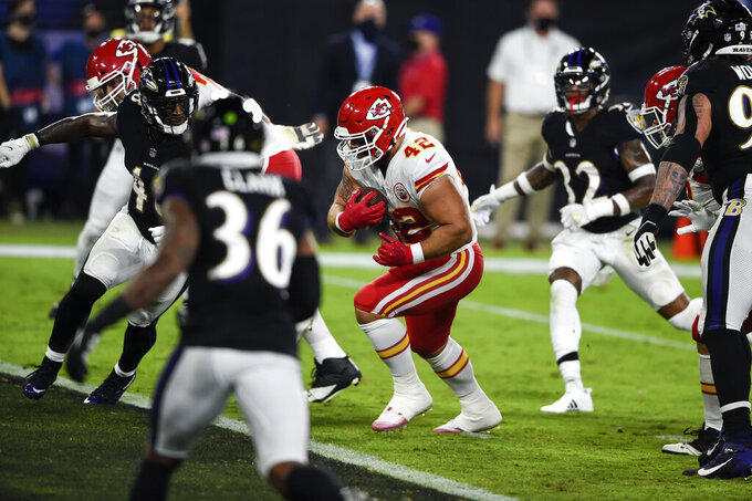 Kansas City Chiefs running back Anthony Sherman (42) runs for a touchdown after his pass reception during the first half of an NFL football game against the Baltimore Ravens, Monday, Sept. 28, 2020, in Baltimore. (AP Photo/Gail Burton)