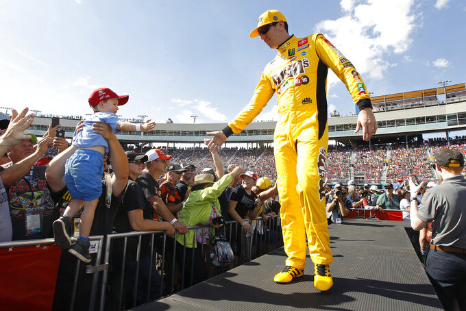Kyle Busch greets fans during driver introductions prior to the NASCAR Cup Series auto race at ISM Raceway, Sunday, Nov. 10, 2019, in Avondale, Ariz. (AP Photo/Ralph Freso)