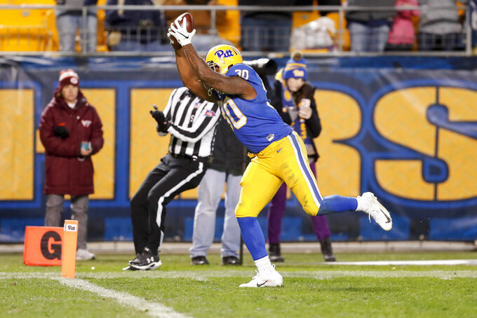Pittsburgh running back Qadree Ollison (30) starts to sommersault as he goes into the end zone for a touchdown after a 97-yard run from scrimmage against Virginia Tech in the fourth quarter of an NCAA football game, Saturday, Nov. 10, 2018, in Pittsburgh. Pittsburgh won 52-22. (AP Photo/Keith Srakocic)