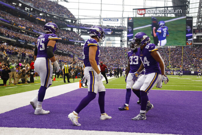 Minnesota Vikings wide receiver Adam Thielen, second from left, celebrates with teammates after catching a 6-yard touchdown pass during the first half of an NFL football game against the Philadelphia Eagles, Sunday, Oct. 13, 2019, in Minneapolis. (AP Photo/Bruce Kluckhohn)