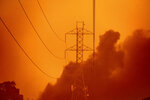 Smoke wafts past power lines as the Glass Fire burns in Santa Rosa, Calif., Monday, Sept. 28, 2020. (AP Photo/Noah Berger)