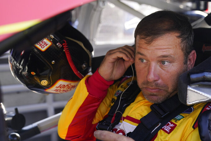 Ryan Newman sits in his car before qualifications for the NASCAR Series auto race at Indianapolis Motor Speedway, Sunday, Aug. 15, 2021, in Indianapolis. (AP Photo/Darron Cummings)