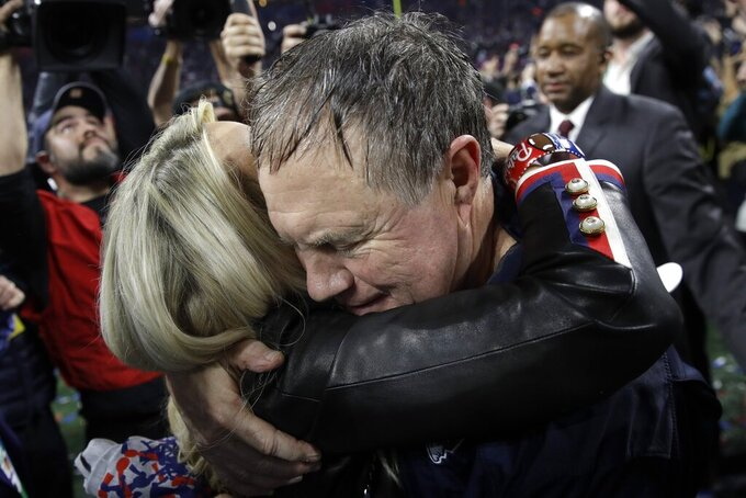 New England Patriots head coach Bill Belichick and girlfriend Linda Holliday celebrate after the NFL Super Bowl 53 football game against the Los Angeles Rams, Sunday, Feb. 3, 2019, in Atlanta. The Patriots won 13-3. (AP Photo/Patrick Semansky)