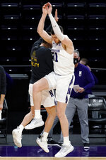 Northwestern forward Robbie Beran, right, celebrates with guard Eric Zalewski after making a 3-point basket against Nebraska during the first half of an NCAA college basketball game in Evanston, Ill., Sunday, March 7, 2021. (AP Photo/Nam Y. Huh)